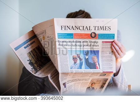 Paris, France - Nov 5, 2020: Woman Reading In Living Room The Latest Financial Times Newspaper Featu
