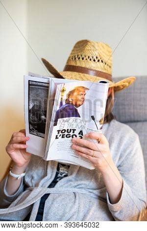 Paris, France - Nov 5, 2020: Woman Reading In Living Room The Latest Magazine Featuring On Page The