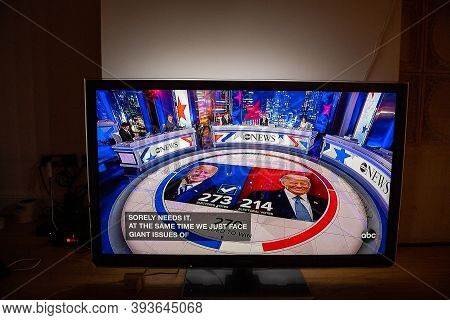 Paris, France - Nov 7, 2020: Living Room Tv On The Wooden Floor Featuring Latest News On Abc That De