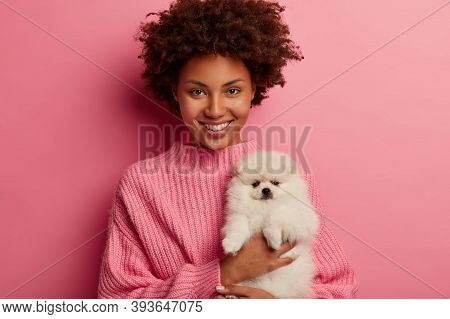 Studio Shot Of Pretty Woman Poses With Lovely Pet, Makes Memorable Photo With Four Legged Friend, Sm