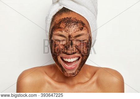 Photo Of Lovely Delighted Woman With Pleased Face Expression, Gets Pleasure From Beauty Treatments,