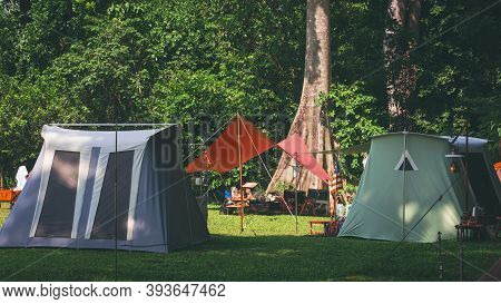 Sunlight And Shade On Surface Of Field Tents Group With Table Set And Outdoor Kitchen Equipment In C