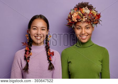 Portrait Of Happy Mixed Race Women In Warm Clothes, Hair Decorated With Autumn Leaves, Express Good