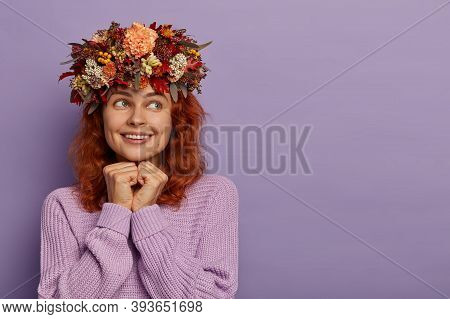 Pleased Foxy Girl Keeps Hands Under Chin, Recalls Heartwarming Moment, Looks Aside With Toothy Smile