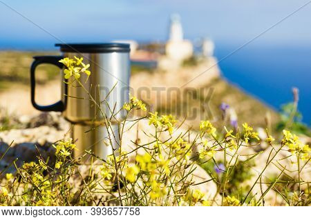 Thermal Mug, Thermos On Nature. Travel Destination, Mesa Roldan Lighthouse In The Background. Campin