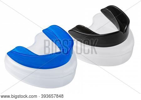 Two Boxing Shields, Blue And Black, Lie On Plastic Cases, Protection Of Teeth And Lips, On A White B