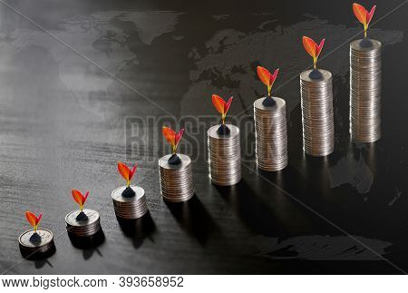 Silver Bar Graph Behind The Investment Concept, The World Economy On The World Map Background And Gr
