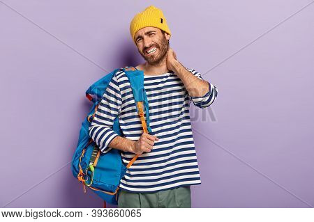 Fatigue Tourist Touches Neck, Feels Stiffness, Dressed In Casual Clothes, Carries Rucksack, Has Pain