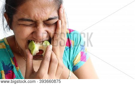 Woman Put Her Hand On Her Cheek Due To Toothache. Asian Woman Is Suffering Of Toothache. Young Woman