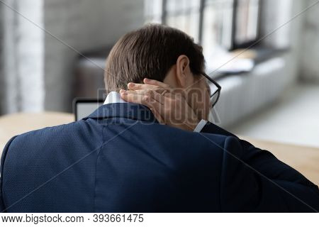 Young Businessman Suffering From Muscles Tension Spasm.