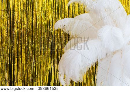 White Ostrich Feathers On Gold Texture Background, 20s In Luxurious Retro Flat Lay Creative Concept.