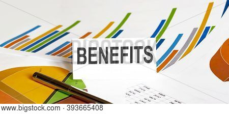 Benefits Text On Paper On The Chart Background With Pen