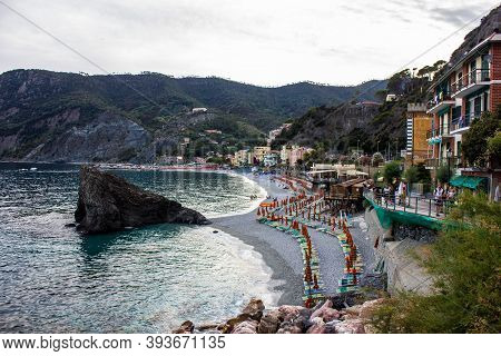 Monterosso Al Mare, Italy - July 8, 2017: View Of Fegina Beach And Traditional Colorful Houses In Mo