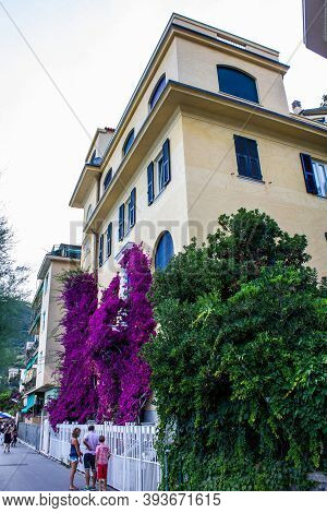 Monterosso Al Mare, Italy - July 8, 2017: View Of Tourists And Colorful Houses In Monterosso Al Mare