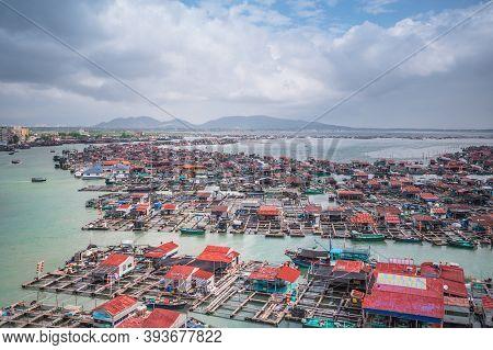 Lingshui, Hainan, China - Nov 13, 2019. Floating Local Fishing Village Houseboats With Fish Farms Ae