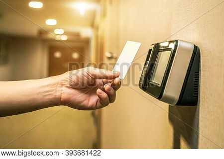 Close Up Hand Of Security Man Using The Id Card To Scanning At The Access Control System Machine For