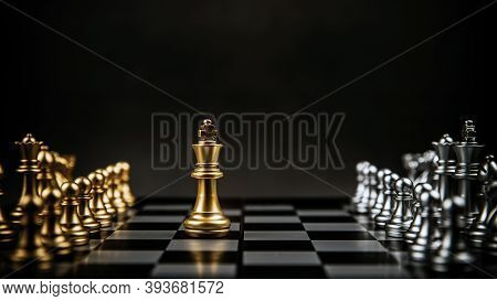 King Golden Chess Standing Confront Of The Silver Chess Team To Challenge On Chess Board. Concept Of