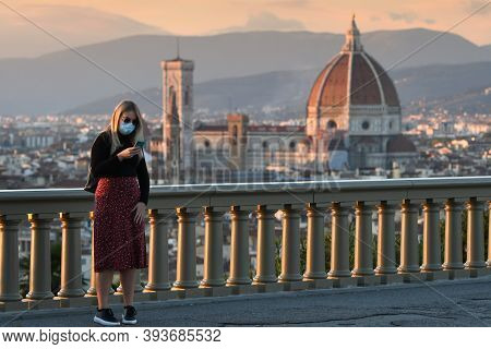 Florence, October 2020: Girl Wearing Maskat Piazzale Michelangelo In Front Of The Cathedral Of Santa