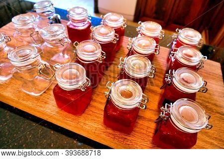 Small Jars Of Homemade Sweet Chilli Sauce Made From Home Grown Organic Chillies. Sometimes Called Ch