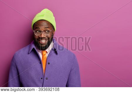 Glad Black Hipster In Fashionable Clothes, Optical Glasses Happy To Hear Very Good Idea, Smiles Joyf