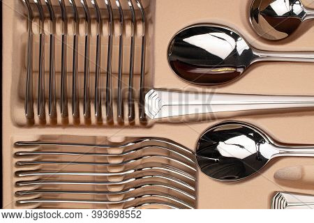 Steel Spoons And Other Silverware On Box