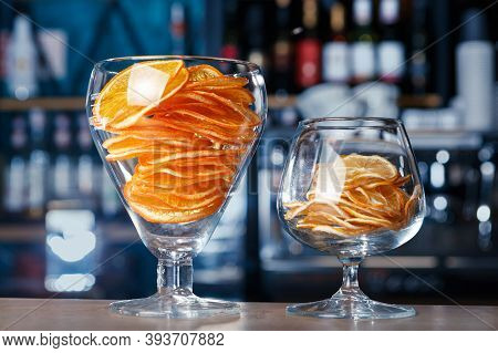 Dried Oranges And Lemons In Large Glasses On The Bar, Soft Focus, Selective Focus