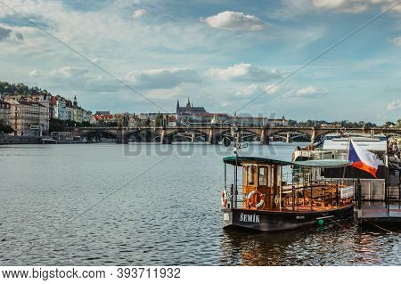 Prague,czech Republic-september 3, 2020. Postcard View Of Vltava River And Small Wooden Ferry Boat,p