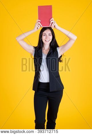 Smiling Happy Young Woman College University School Student Holding Book Isolated On Yellow Backgrou