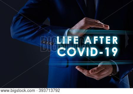 Covid-19 Predictions. Man And Text On Dark Background, Closeup