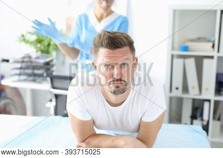 Man In Medical Office At Proctologist. Helping Patients With Bowel Problems Concept