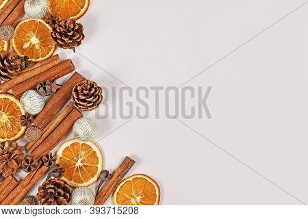 Seasonal Winter Flat Lay With Dried Orange Slices, Fruit Husks, Cinnamon Sticks And Christmas Tree B