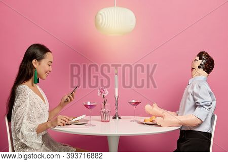 Perfect Relationship Dream Concept. Happy Good Looking Woman Uses Modern Mobile Phone For Searching