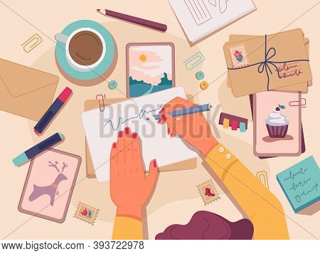 Flat Lay Of Table With Postcards And Letters For Holidays. Woman Writing On Paper, Making Handmade G