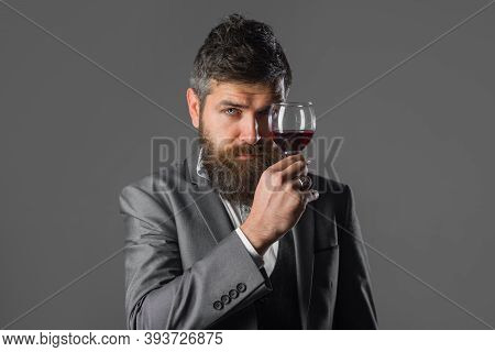 Wine. Bearded Man With Glass Of Wine. Tasting Alcohol. Red Wine. Bearded Man With Alcohol. Man In Su
