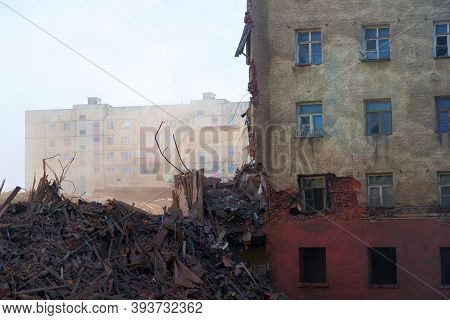 Pile Of Demolition Rubble. Gray Rubble At A Building Site.