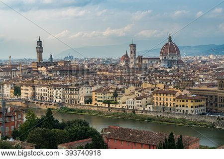 Florence Old City Skyline At Sunset With Ponte Vecchio Over Arno River And Cathedral Of Santa Maria
