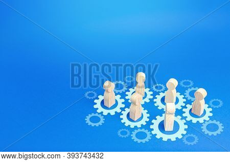 Figures Of People Interact With Gears. Joining Efforts And Cooperation. Corporate Machine. Communica