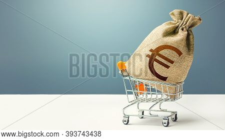 Euro Money Bag On A Shopping Cart. Profits And Super Profits. Loans And Microloans. Minimum Living W