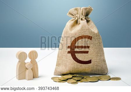 Euro Money Bag With Money And Family Figurines. Financial Support For Social Institutions. Investmen