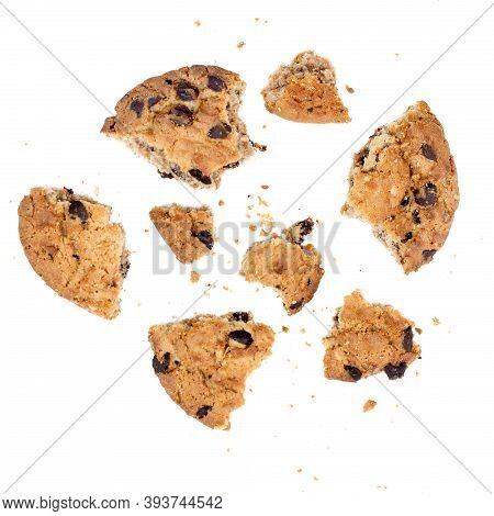 Close Up Of Chocolate Chip Cookie Pieces With Crumbs Isolated On White Background