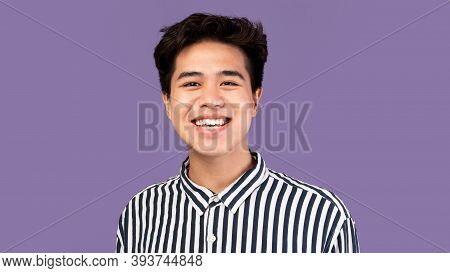 Closeup Headshot Portrait Of Smiling Asian Guy Looking At Camera, Wearing Striped Shirt, Posing Isol