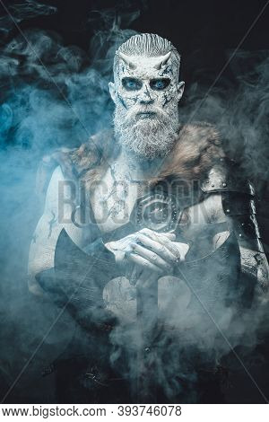 Nordic Savage Undead In Dark Armour With White Skin And Blue Eyes Holding His Huge Axe In Smokey And