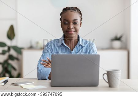 Female Entrepreneurship. Portrait Of Young Black Businesswoman Posing At Desk In Office, Confident M