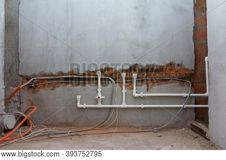 Water Supply System Installation. Laying Pipes In The Wall. Cold And Hot Water Supply In The Apartme