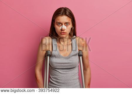 Health Insurance And Work Accident Concept. Disabled Woman With Many Bruises And Wounds, Bandage On