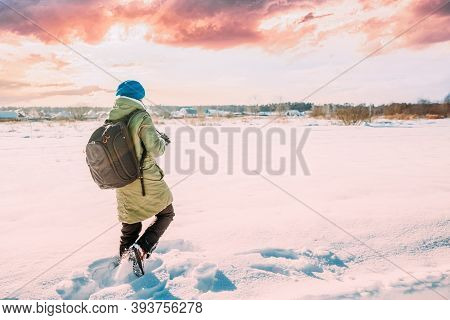 Young Woman Tourist Lady Photograph Taking Pictures Of Snowy Landscape In Sunny Winter Day. Active L