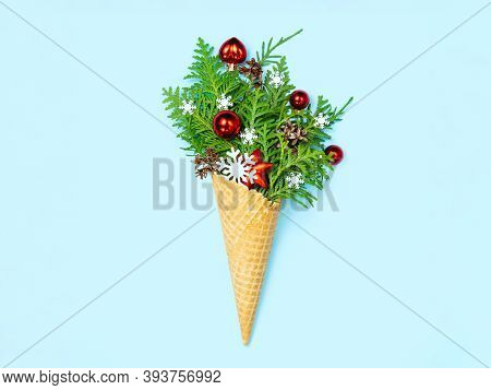 Ice Cream Cone With Thuja Sprigs And Christmas Toys. Blue Background. New Year Card. Copy Space, Fla