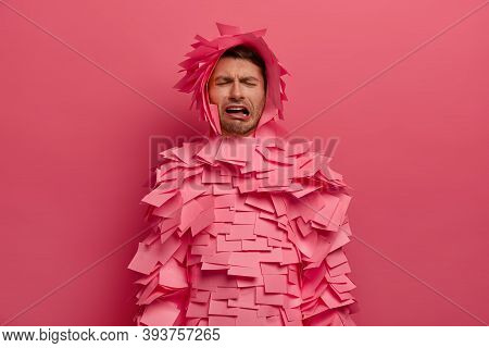 Frustrated Unhappy Man Cries With Despair, Expresses Negative Emotions, Wears Sticky Notes Around Wh