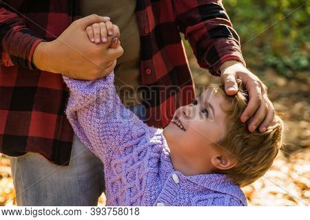 Fathers Parental Support. Help Kid Explore World. Dad Hold Hand Of Little Boy. Manly Father Upbringi