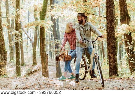 Romantic Date With Bicycle. Bearded Man And Woman Relaxing In Autumn Forest. Romantic Couple On Date